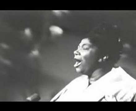 Mahalia Jackson, His Eye is on the Sparrow. This one is for you, Aunt Helen.