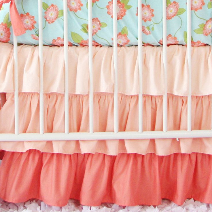 Coral Floral Crib Set - This bold floral sheet + ombre ruffle skirt is the perfect focal point in a girly nursery.