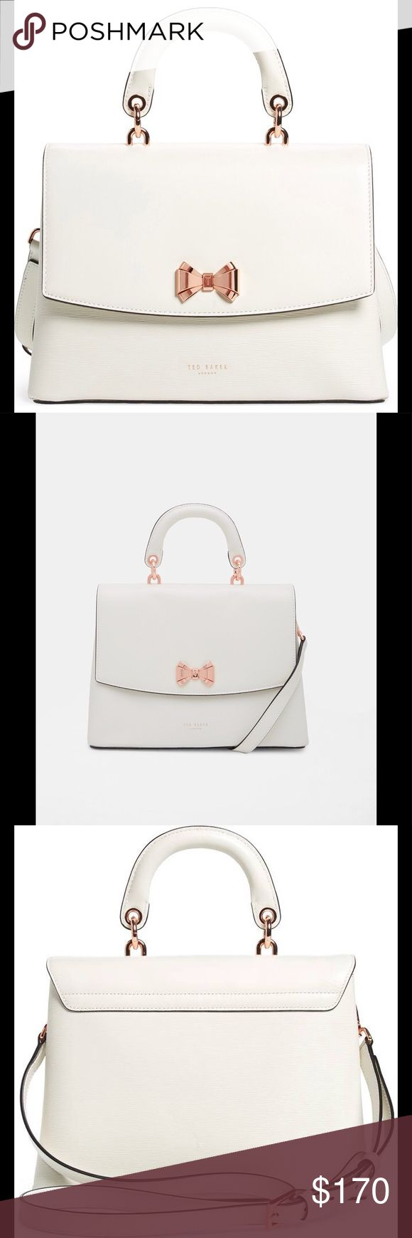 """Lady Bow Flap Top Handle Leather Satchel Channel a sense of ladylike appeal with the LAUREE bag on your arm. This smooth leather piece boasts a structured shape that's softened by Ted's signature bow to the front. Couple with floaty dresses to further the decorous feel.  11 1/4""""W x 8""""H x 5""""D. (Interior capacity: small.) 3 3/4"""" strap drop; 20 3/4"""" - 23"""" convertible strap drop.  Curved top handle Bow detail to the front Magnetic closure Fully lined H20cm x W28cm x D12cm Handle Drop: 9cm…"""