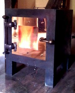 The Cube Uber burner 8KW 100KG monster half a metre in dimensions... here raging in a French farmhouse..