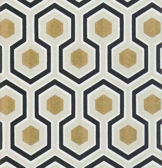 Now trending in home decor:  honeycomb/hexagon.  British wallpaper designer David Hicks' Hexagon Wallpaper Black grey and gold hexagon design.
