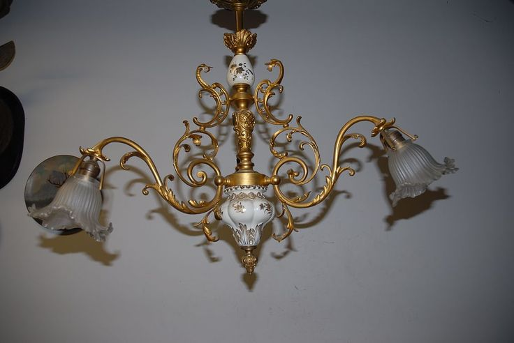 An Antique Gilt Bronze / Porcelain 3-light Chandelier with Glass Shades, from circa 1900. Description from rubylane.com. I searched for this on bing.com/images