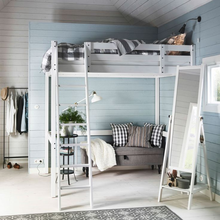A white bedroom with a white STORÅ loft bed, EMMIE grey quilt cover and a grey STOCKSUND bench