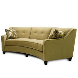 The Sofa Features And Arced Design In A Lovely Mushroom Color This