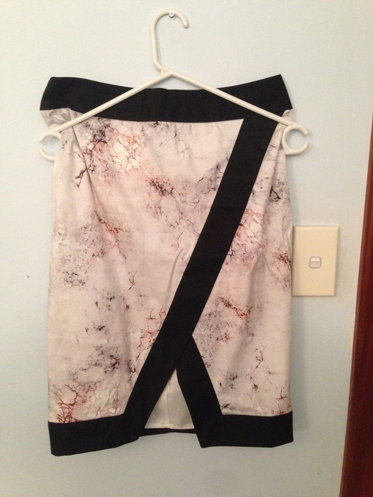Pencil skirt (I think) with v cut out, defined by waist and base