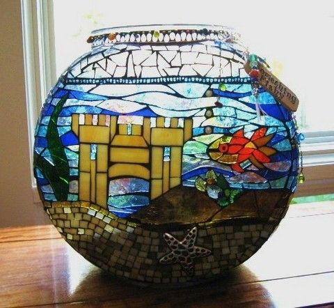 Mosaic applied to fish bowl. Used as a votive.  Love this!