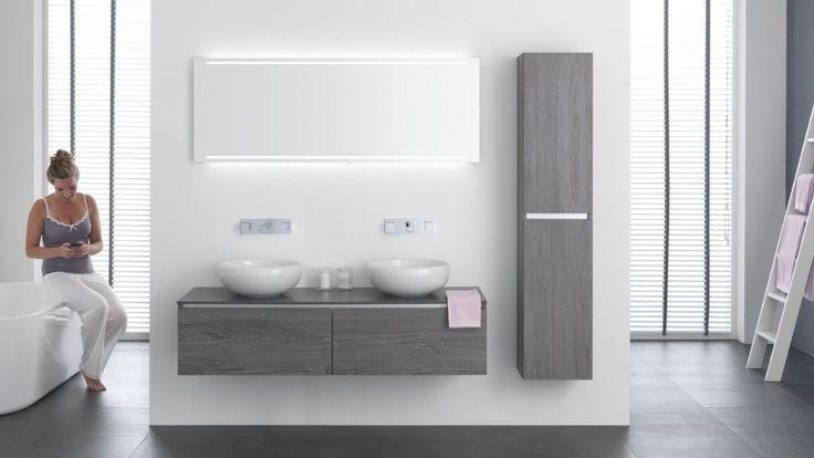 Thebalux stone serie met twee ronde waskommen, bij Ennovy badkamers, kleur eiken grijs