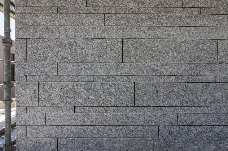Irregular Bands Of Rough Granite Clad The Exterior Of