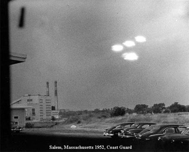 Salem, Massachusetts. July 16, 1952. During the peak of the 1952 UFO Flap, Shel Alpert, a USCG seaman on duty in the Coast Guard Weather Office at the Salem Coast Guard Station, saw four brilliant lights in the sky. He called another Guardsman to see the lights, but in those few seconds the lights had become more dim. When they brightened again, he quickly took a single photograph through the window of the office.