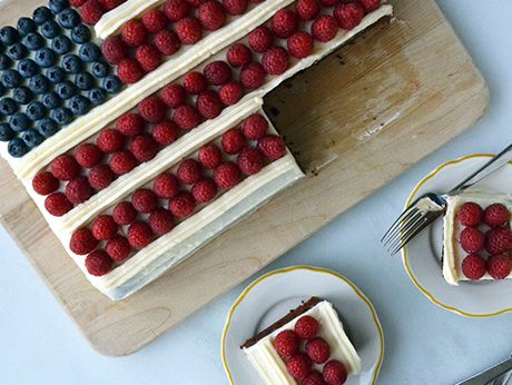 Not your typical white cake Flag Cake. Chocolate cake with cream cheese frosting elevates flavors of fruit decorations. Mmmmmmm!!!!                July 4th Flag Cake Recipe   at Epicurious.com