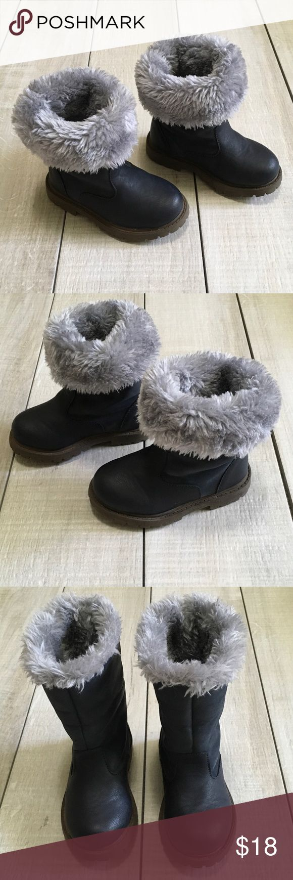 Carters Navy Faux Fur Boots Size 7. Carters navy boots with faux fur that can be worn rolled down or rolled up. Super cute and match everything! Good used condition. Box included.  🎀Posh Ambassador 📫Fast Shipping 🚭Smoke free home/Fragrance free laundry products 🤑Offers welcome/Bundle offer discounts Carter's Shoes Boots