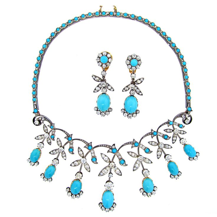 """Circa 1850 Turquoise and Diamond Demi Parure. Rare silver top 18kt. yellow gold back suite consisting of chandelier earrings and necklace that was designed to attach to a tiara frame. The necklace and earrings are set with 266 of old mixed rose, European, and mine cut diamonds the largest center diamond weighing approx. 1.8 cts. Total diamond weight approx. 25 cts.The turquoise drops graduate from approx. 13 mm. - 16 mm. The necklace measures 16"""" with approx 3"""" drops."""