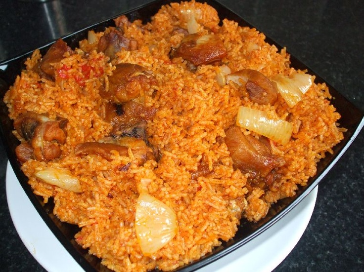 African food, Nigerian food  Jollof Rice. Jollof rice - a popular dish in Nigeria, Ghana, Senegal, etc. My friend in high school would bring this in often and we would devour it for breakfast. It is spicy, has a tomato and onion base, and chicken or beef is popular with it as well.