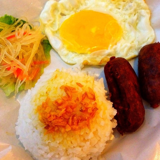 Filipino breakfast. Fried rice, egg, lucban longganisa with achara