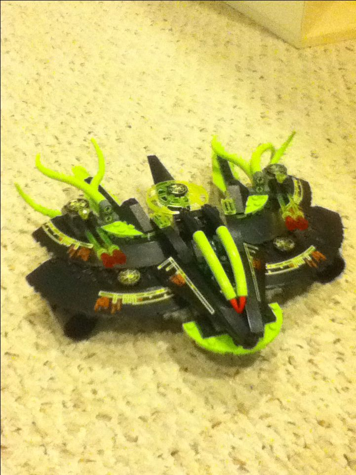 An alien cruiser based off of LEGO Mars Mission sets. This was a challenge because I wanted the wings to bend outward.