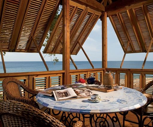 love bermuda shutters- perfect beach house porch!