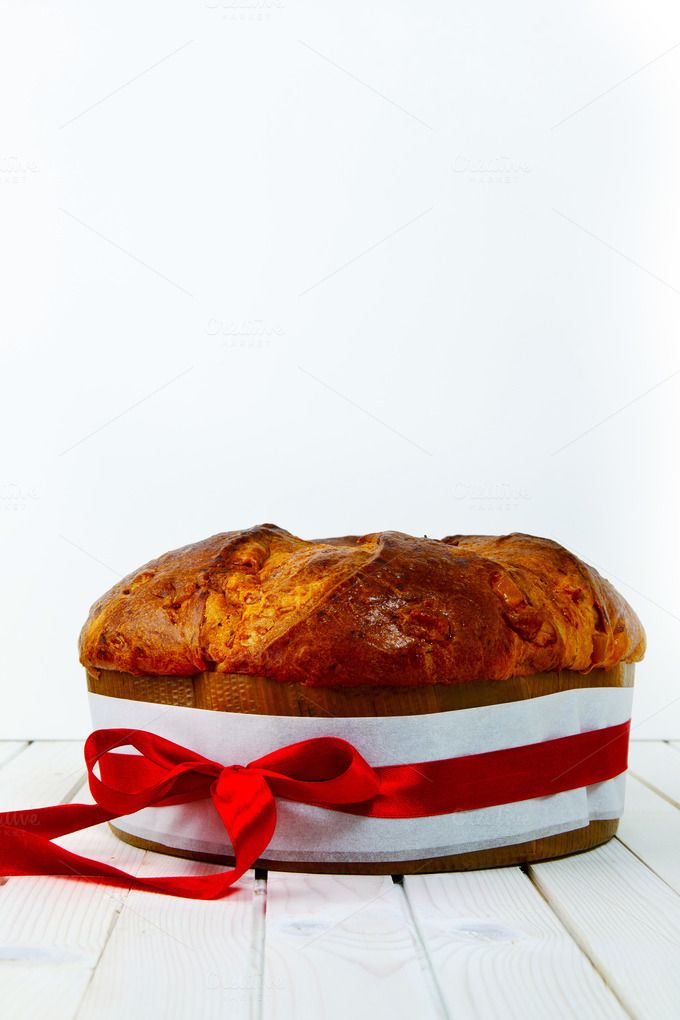 panettone with a red bow on white by IriGri on @creativemarket