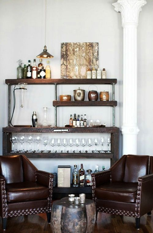 bar cart as a furniture piece. great set up for a #mancave or #bachelor pad. AMAZING