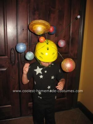 Space...the final frontier. This year, our 5-year-old wanted to be... The Solar System!!  Gulp.  After much debate and trying to convince our son that we needed a back-up plan, my