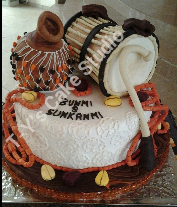 Round Wedding Cakes - Yoruba traditional wedding cake. Talking drum is vanilla coconut cake while base and calabash is fruit cake, Every other thing on the cake is gum paste including the beads,kola nut and drum stick.