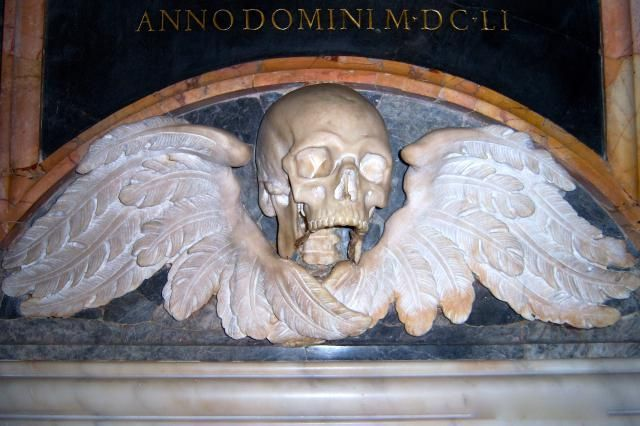 """A Prayer for the Holy Souls in Purgatory: A <a href=""""http://catholicism.about.com/od/history/g/Memento_Mori.htm"""">Memento Mori</a> marks a tomb in the Church of Santa Maria sopra Minerva in Rome. """"Memento mori"""" is Latin for """"Remember, you must die."""" The image reminds us of our own mortality and the judgment to come."""