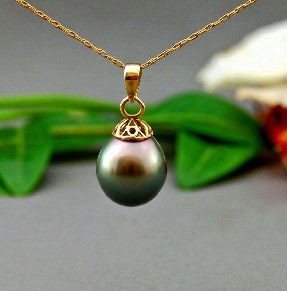 Carolyn Singh - Paloma pendant Tahitain pearl and 14kt gold. https://www.etsy.com/listing/156276454/paloma-tahitian-pearl-pendant-pearl?