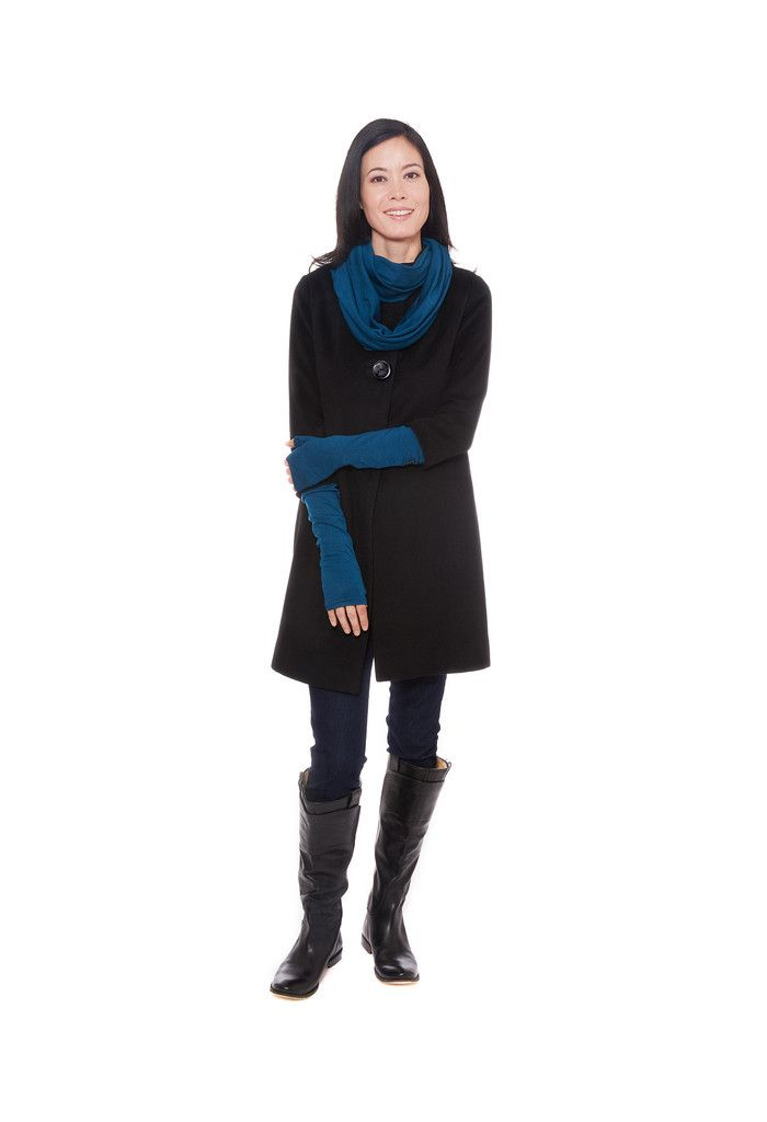 Blue merino wool arm warmers with matching infinity scarf by Jennifer Fukushima.  Styled with vintage black wool coat and tall black leather boots.