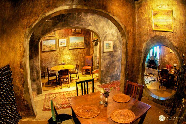 Inside Muratie Wine Tasting room where Tim stands still
