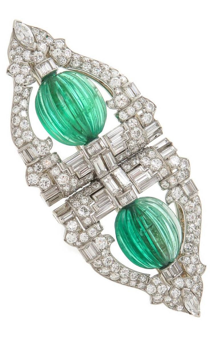 Emerald diamond and platinum dress clips circa 1930s by raymond yard