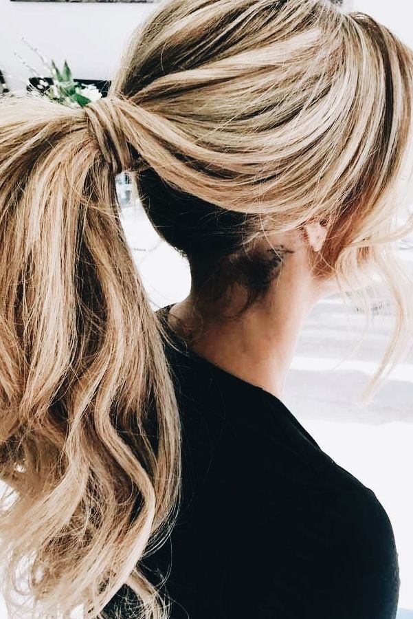 Wrap pony with long waves in your extensions and back combing at the crown for more volume.  The perfect hurried day look, sans fussing with it.