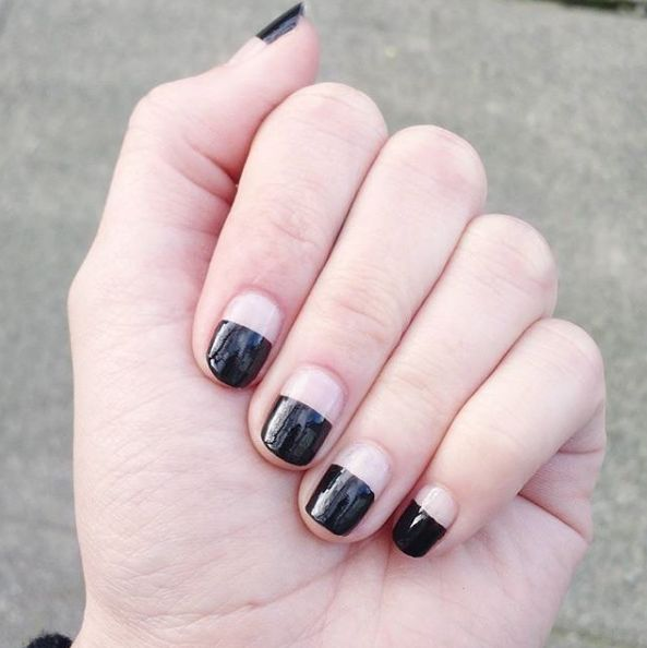 Black nails also look great with a half-and-half French manicure. | 16 Ideas For Black Nail Polish That You'll Love If You Have A Cold, Black Heart