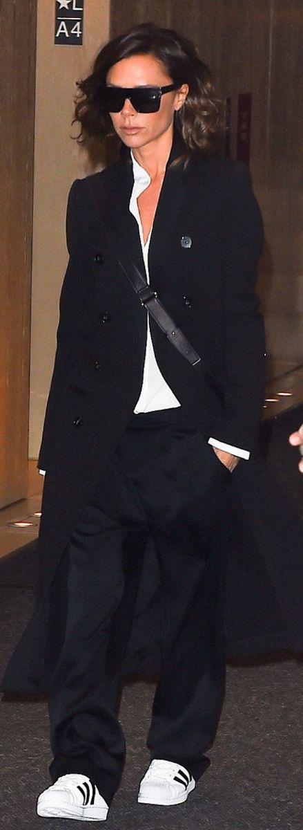 Victoria Beckham in Coat, shirt, pants, sunglasses, and bag – Victoria Beckham  Shoes – Adidas http://bellanblue.com
