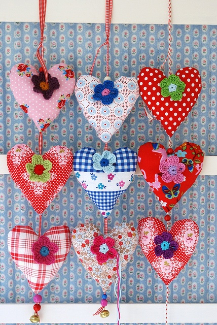 hearts by dutch blue, via Flickr...cloth hearts embellished with crocheted flowers.. These are very colorful and pretty!!