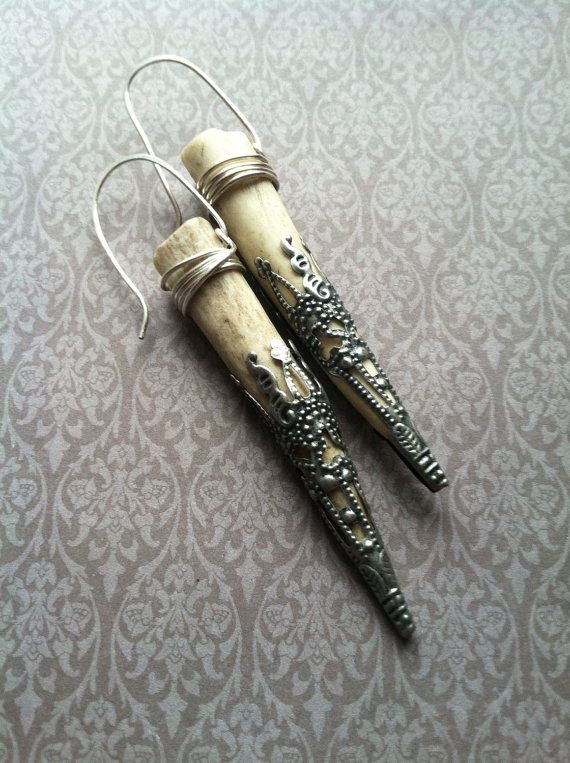 2 naturally-shed deer antler points have been wrapped with sterling silver wire and capped with vintage silvertone filigree end caps.