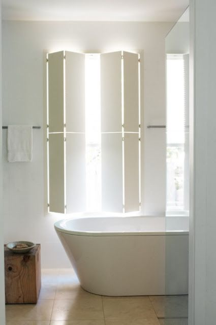 Bathroom wall untiled, painted white. A light and airy Australian beach house