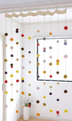 Felt ball curtain. Could be done with paper dots. Love this for a little girls room.