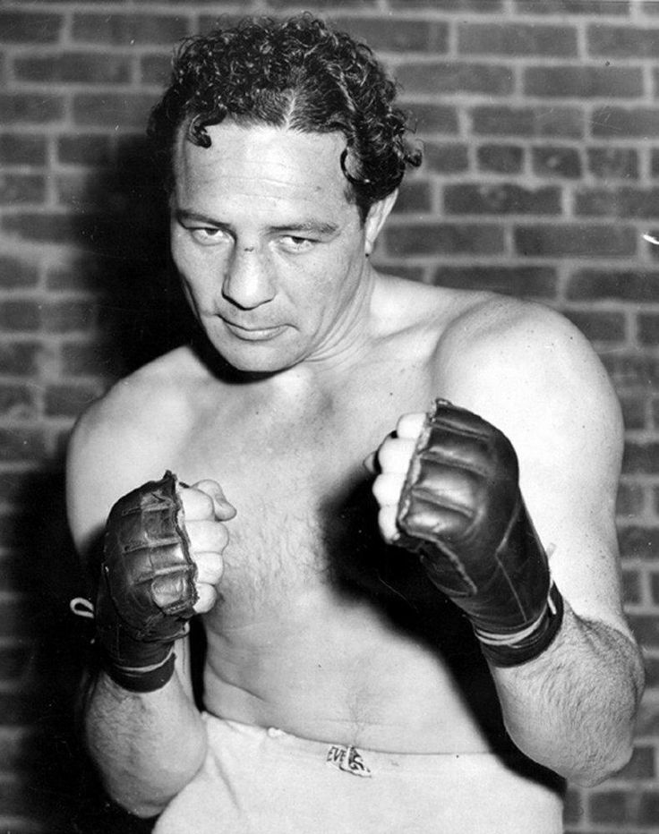 """I define fear as standing across the ring from Joe Louis and knowing he wants to go home early."" ~ Max Baer"