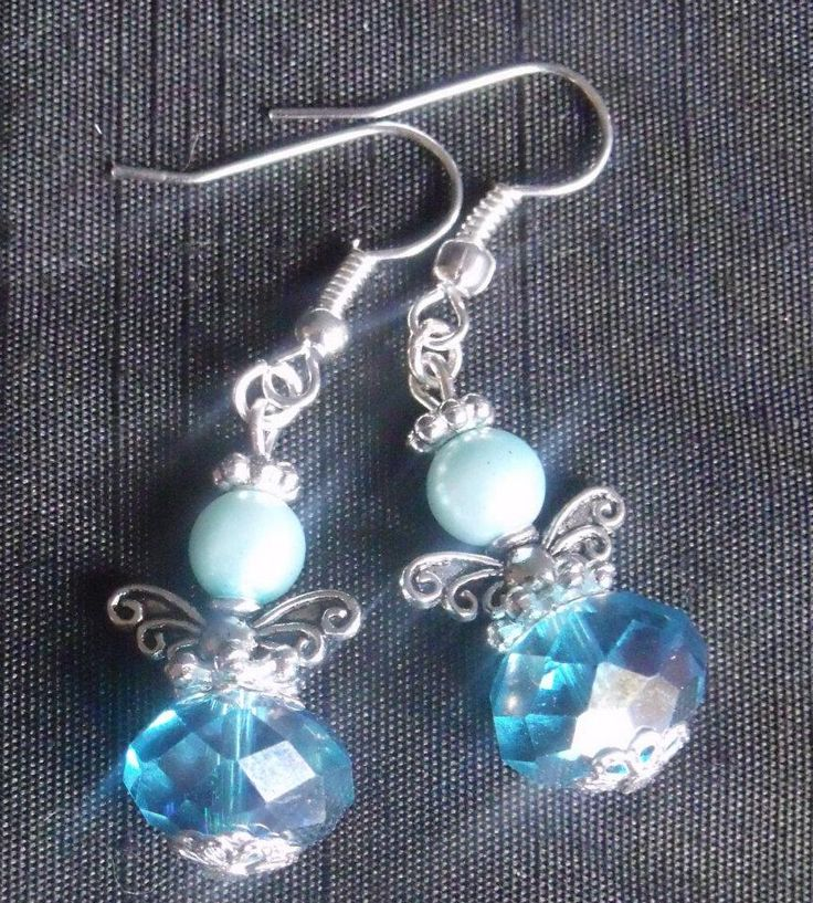 "Ice blue glass beads, Swarovski Pearls and silver plate make up these ""Guardian Angel"" Earrings."