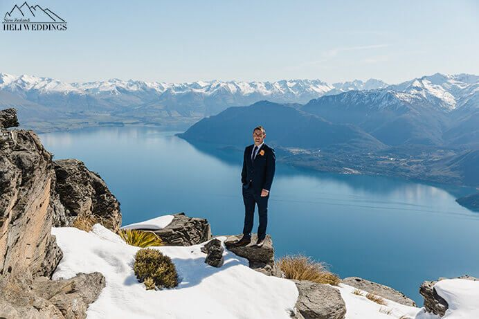 Groom stands on The Ledge. Destination Heli weddings Queenstown.
