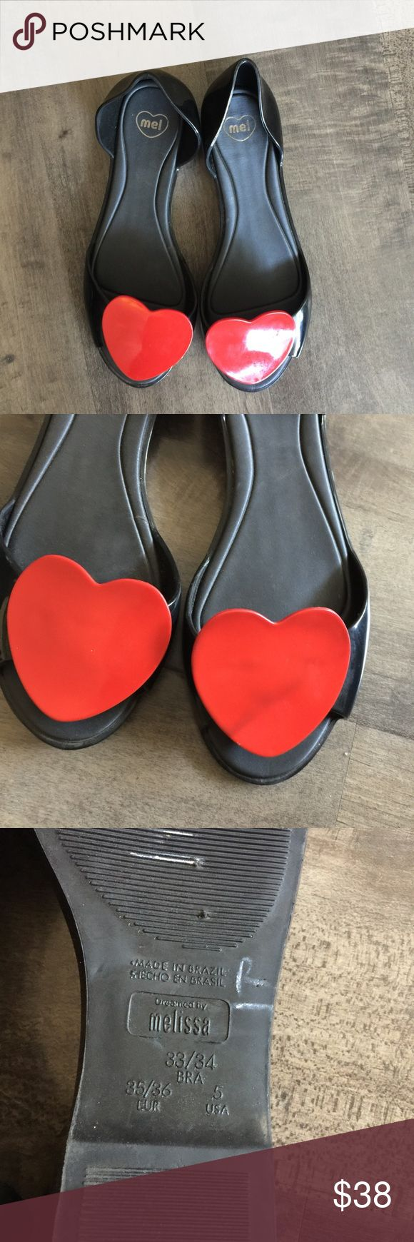 Melissa Flats with Heart Detail The cutest Flats by Melissa. The classic black flat features a big red heart at the toe of each foot. Wear them with skinny jeans and a simple tank for summer! mel by melissa Shoes Flats & Loafers