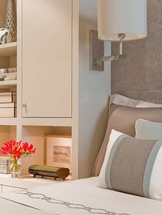 Cozy, built-in storage around the bed - great for tight NYC apartments. By Terrat Elms Interior Design.