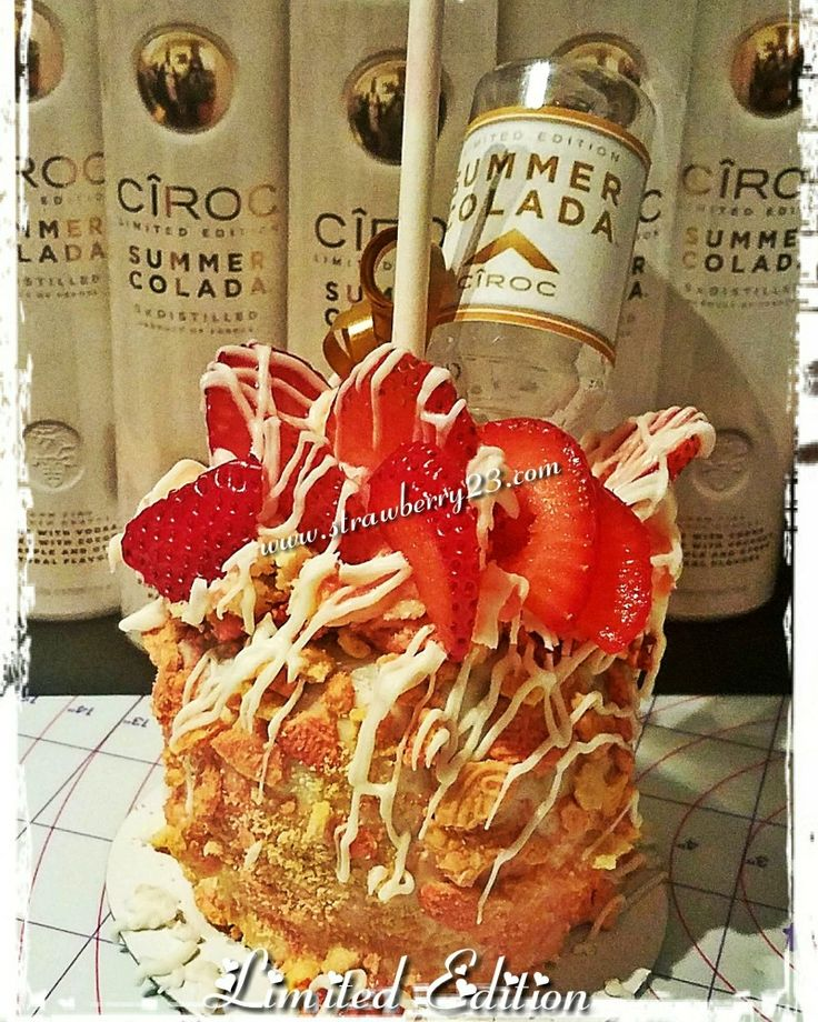 Strawberry cheesecake stuffed caramel and chocolate covered apple infused with Ciroc Summer Colada