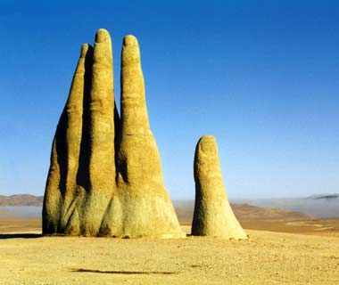 'Hand of the Desert' (c.1980). In the desert, about 75km south of the town of Antofagasta, Chile, a 36' tall hand protrudes out of the sand. 'Mano de Desierto' is a work of the Chilean sculptor Mario Irarrázabal. via travel and leisure