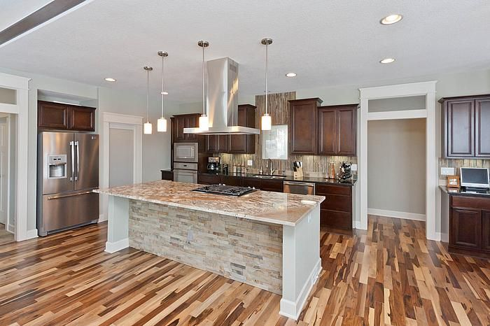 Designer johnnie flooring tile granite and sarah for Brazilian pecan hardwood flooring
