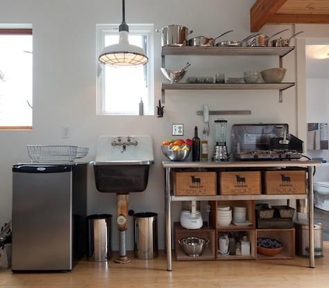Admired recently in the New York Times: this low-cost kitchen in a 250-square-foot converted garage in Seattle, designed and built by artist and designer Michelle de la Vega using a mix of new elements and reclaimed materials from local salvage yards.  Great for a guest house.http://remodelista.com/posts/steal-this-look-instant-camp-style-kitchen?_from=related