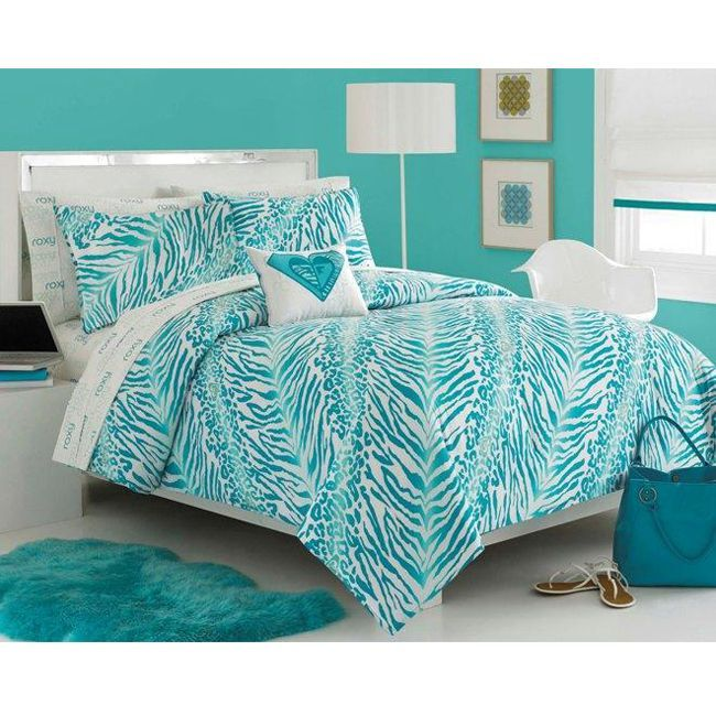 Zebra Animated Teal Bed Cover On White Divan Design Nearby Stand Lamp And White Mica Chair Also Teal Shag Rug And Marble Flooring | Aquatic Teal Bedroom Decor Ideas | 21 Inspiring Bedroom Design Ideas | jengooch.Com