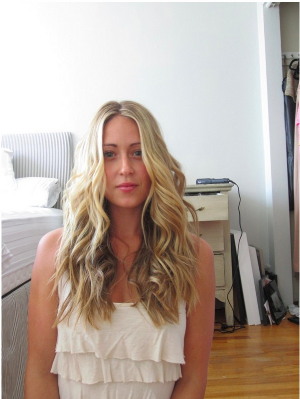 A loose wave texture is quick and easy with the Sam Villa Sleekr® iron.. Use a horizontal section to part off the top and crown areas (these can be combined into one area)- clip this hair up loosely.