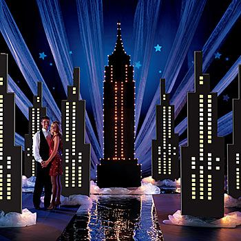 Our Still of the Night Theme Kit features towering skyscraper columns and a lighted Empire State Building. Bring on the fun and romance of New York City.