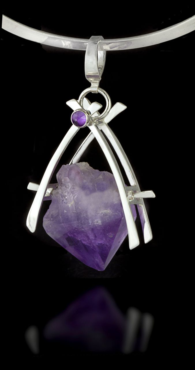 Amethyst Pendant.  The simple setting allows the amethyst to be framed  in its own beauty.  Amethyst promotes calmness, clarity and serenity.