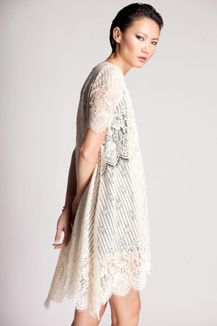 Elegant corded lace style with a pretty tent silhouette & asymmetric hem. Add edgy romance to your style.
